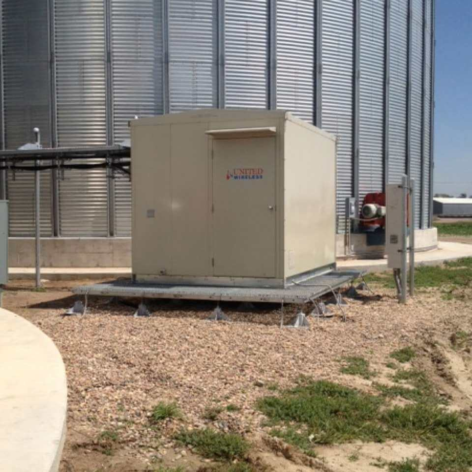 United Wireless in Kansas Independent telephone company using lightweight shelter with antenna using existing grain silo structure.